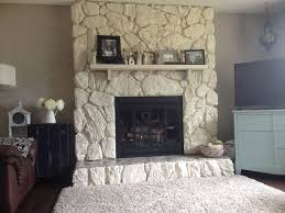 Painted rock fireplace, huge improvement! Makes the room feel so light and  airy compared