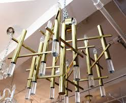 sciolari chandelier in polished brass and lucite