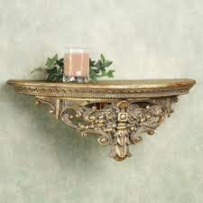 bathroom half round golden carving shelf with candle on the glass placed gray