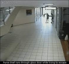 purse thief runs into glass door