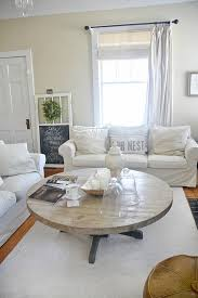 This coffee table with a lift top has caught our attention! Diy Round Coffee Table Liz Marie Blog
