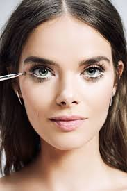 switch to a lighter shade and sketch a thin line under the lower lashes just at the end of the eye