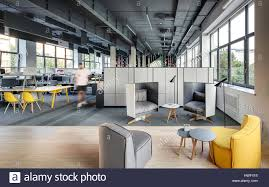 loft style office. Office In A Loft Style With Large Windows, Gray Walls And Concrete Columns. There Are Many Workplaces Computers Shelves Lockers, Relax Zo F