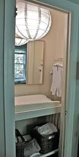 mirror behind changing table gender neutral for little nursery round mirrored