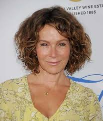 jennifer grey with thick brown curly hair