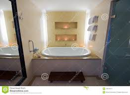 Luxury Bathroom With Large Bath And Lit Candles Stock Photos - Candles for bathroom