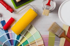 painter and decorator work table with house project color swatches painting roller and paint