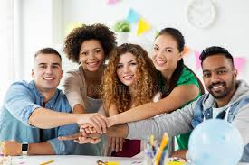 Corporate Celebration Happy Team At Office Party Holding Hands Together Stock Photo