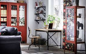 style desk and swivel chair in pine black in a living room with red