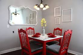 light gray and red make a brilliant combination in this traditional dining space from