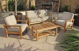 teak wood patio furniture with padded couch