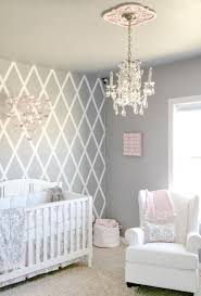 we love everything about this room the walls mobile chandelier the ceiling medallion and glider such a beautiful nursery stella gray bedding