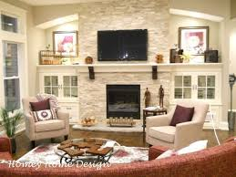 love the lighting shelves and cabinets on either side of the fireplace for all my