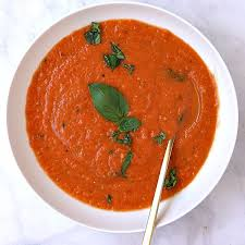 a bowl of fresh tomato basil soup made from fresh tomatoes and bell pepper