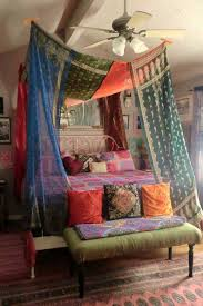 This is Bohemian gypsy to the extreme. The ornate linens, lace, fringe,  wrought iron bed and vintage wallpaper all combine together to create this  ultra ...