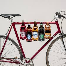 for the cyclist who has everything except a clever way to carry their beer sur son velo la bouclee have designed this clever solution