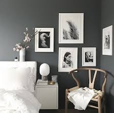 a grey and white bedroom by