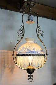 a rare chandelier of white frosted glass and brass decorated with pearls and dutch scenes