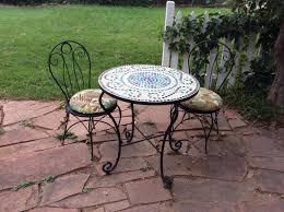 for 25 and redesigned the mosaic top freshened up the iron with a can of black spray paint the chair cushions i sewed with fabric from hobby lobby