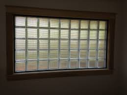 it can be siliconed into a vinyl frame or laid in place using waterproof glass block mortar either method will give you a classy window that is safe