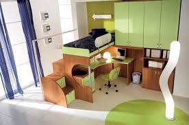 fresh bunk bed in kids room with green wooden cabinet and green desk with green chair and white floor tiles image