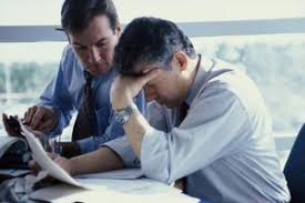 two businessmen thinking in an office benefits analyst job description