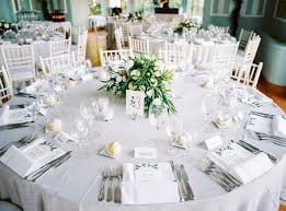 Round Table Settings For Weddings Round Table Set With Menus And Floral Centerpiece For