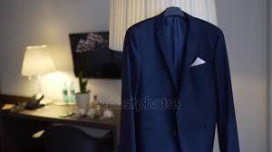 beautiful male dark blue jacket hanging on the chandelier stock