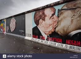 the famous painting of leonid brezhnev kissing erich honecker on the berlin wall east side gallery on famous berlin wall artists with the famous painting of leonid brezhnev kissing erich honecker on the