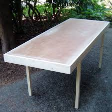 upgrade a used hollow core interior door into a decent lightweight table with the help of a couple of pieces of construction lumber