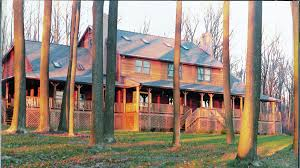 log home designers. an outstanding wrap-around porch is part of the hamilton\u0027s 3291 sq. ft. log home designers
