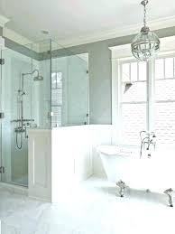 bathtub in shower enclosure ideas beautiful grained accent wall with recessed lights shelving beside head adapter