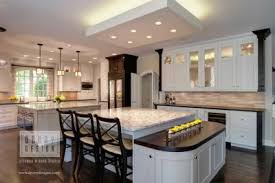 overhead kitchen lighting. focal lighting like these overhead recessed led lights is used for illuminating special design features such as this island with seating kitchen 0