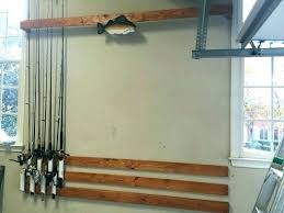 fish pole rack fishing wall holder rod medium size of for home mount plans best fishing rod wall rack