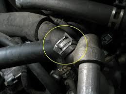 ford f150 f250 how to fix radiator leak ford trucks step 3 remove hoses while the radiator