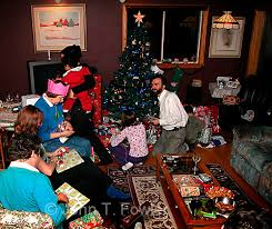 Family Opening Gifts On Christmas Morning  John FowlerGifts On Christmas