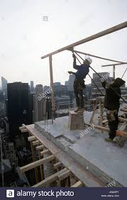 carpenters build framing for reinforced concrete construction in new york city stock image