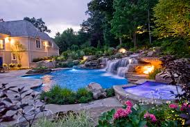 In ground pools with waterfalls Small Backyard Outdoor Lighting For Natural Swimming Pool Waterfall Designs New Jersey Cipriano Landscape Design Backyard Swimming Pools Waterfalls Natural Landscaping Nj