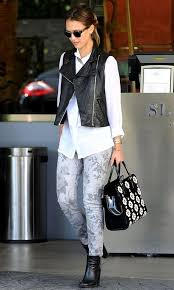 great pairing of a black leather vest white on down and gray fl jeans