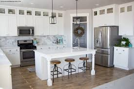 but the glass doors make the kitchen feel taller and more open plus it s so much easier now to know what is in the cabinet