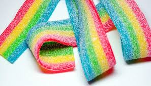 Rainbow colored flat sour belt candies