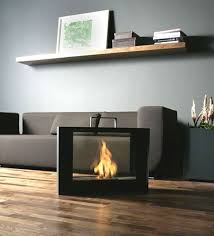 awesome modern style portable fireplace gray sofa wooden floor combined with black mantel design in dark interior decoration
