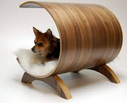 pet pod lounge more of a recliner than a pet bed like an eames chair for your best friend made from bent ply with a walnut veneer via