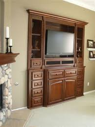 glossy teak armoire entertainment wall unit bedroom wall units