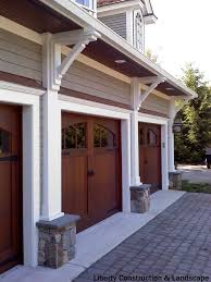 rustic 3 car garage with half rounded windows above the average to install a new garage door is 964