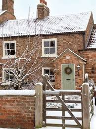 snowy cottage pretty painted front door with wreath for the home cosy front doors and cozy