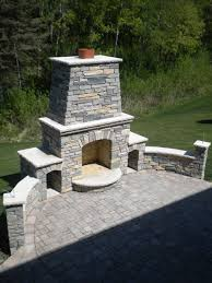 Outdoor Fireplace with chilton and bluestone blended natural stone and  limestone caps