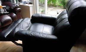 black leather recliner armchair manual used some scuffs due to wear tear