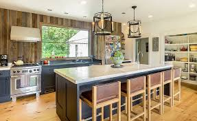 walls of the farmhouse kitchen give old barn wood a new lease of life from