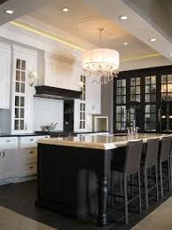 Two Tone Black U0026 White Kitchen Design With Black Mirrored Cabinets, Black  Kitchen Island With Beveled Marble Countertop, Sink In Kitchen Island, ...